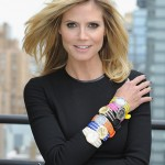 Heidi Klum shows off her stacked watches and bangles (Dimitrios Kambouris/Getty Images for QVC)