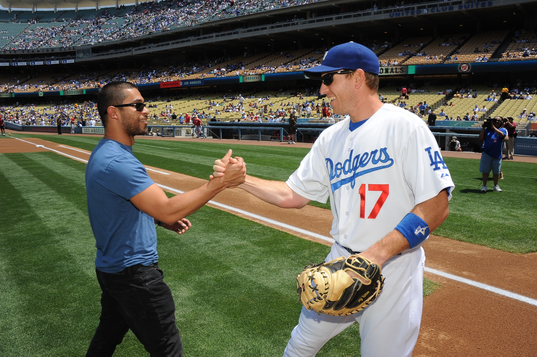 Wilmer Valderrama and a Dodgers player (L.A. Dodgers/Jon Soohoo)