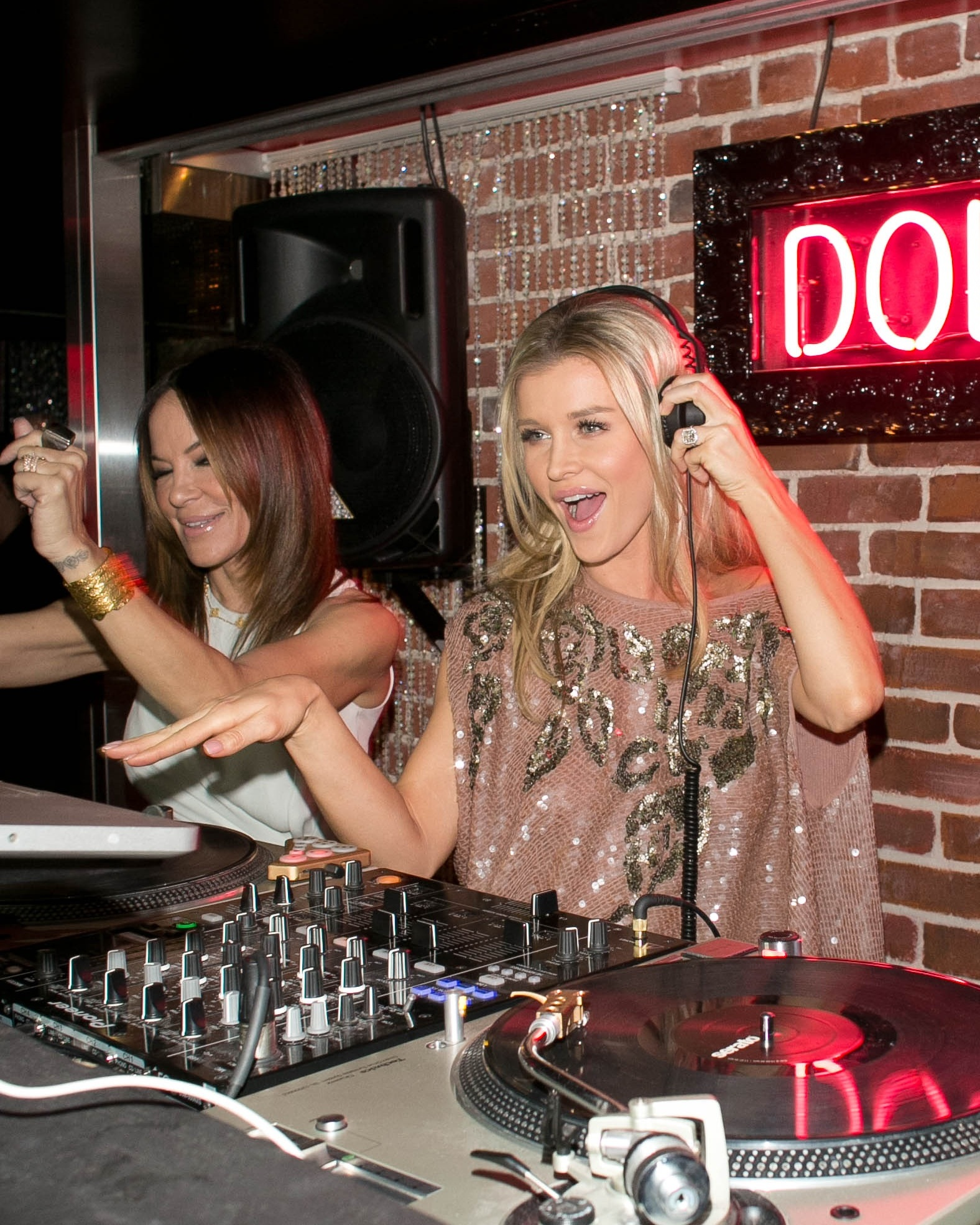 Joanna Krupa (with Robin Antin, left) at the Pussycat Dolls Dollhouse at The Keating Hotel in San Diego Feb. 16. (Robert Benson/WireImage)