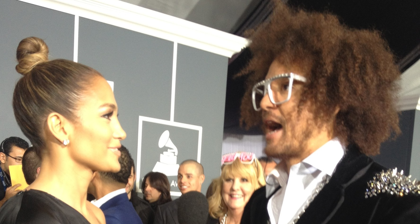 RedFoo interviews Jennifer Lopez at the Grammys for The Tonight Show with Jay Leno in his co-designed Shufflebot cufflinks from CuffLinks.com. (Bryan Allen)