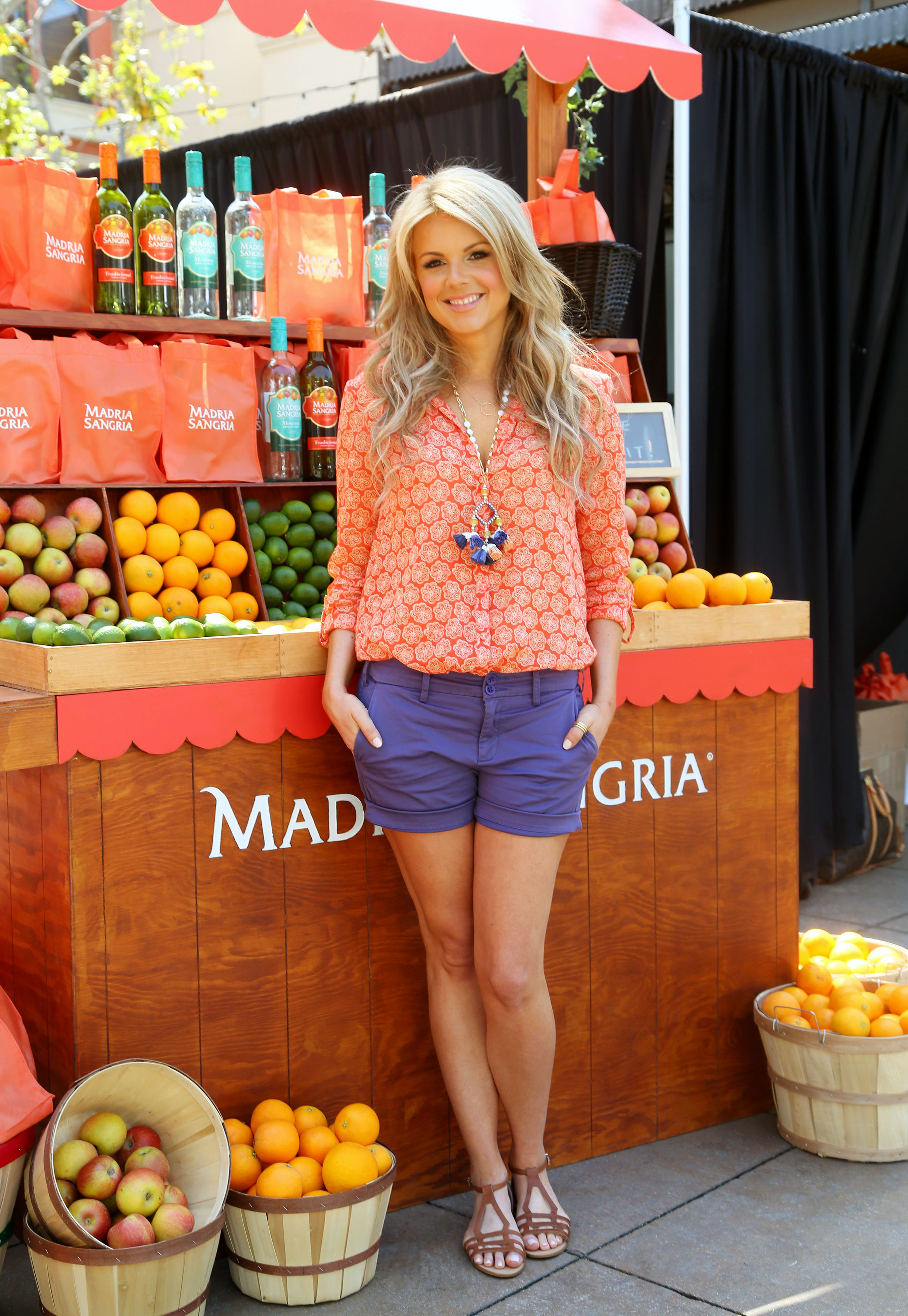 Ali Fedotowsky gears up for Cinco de Mayo at the Madria Sangria Fruit Stand on Extra's set April 26 at The Grove in L.A. (Sara Jaye Weiss)