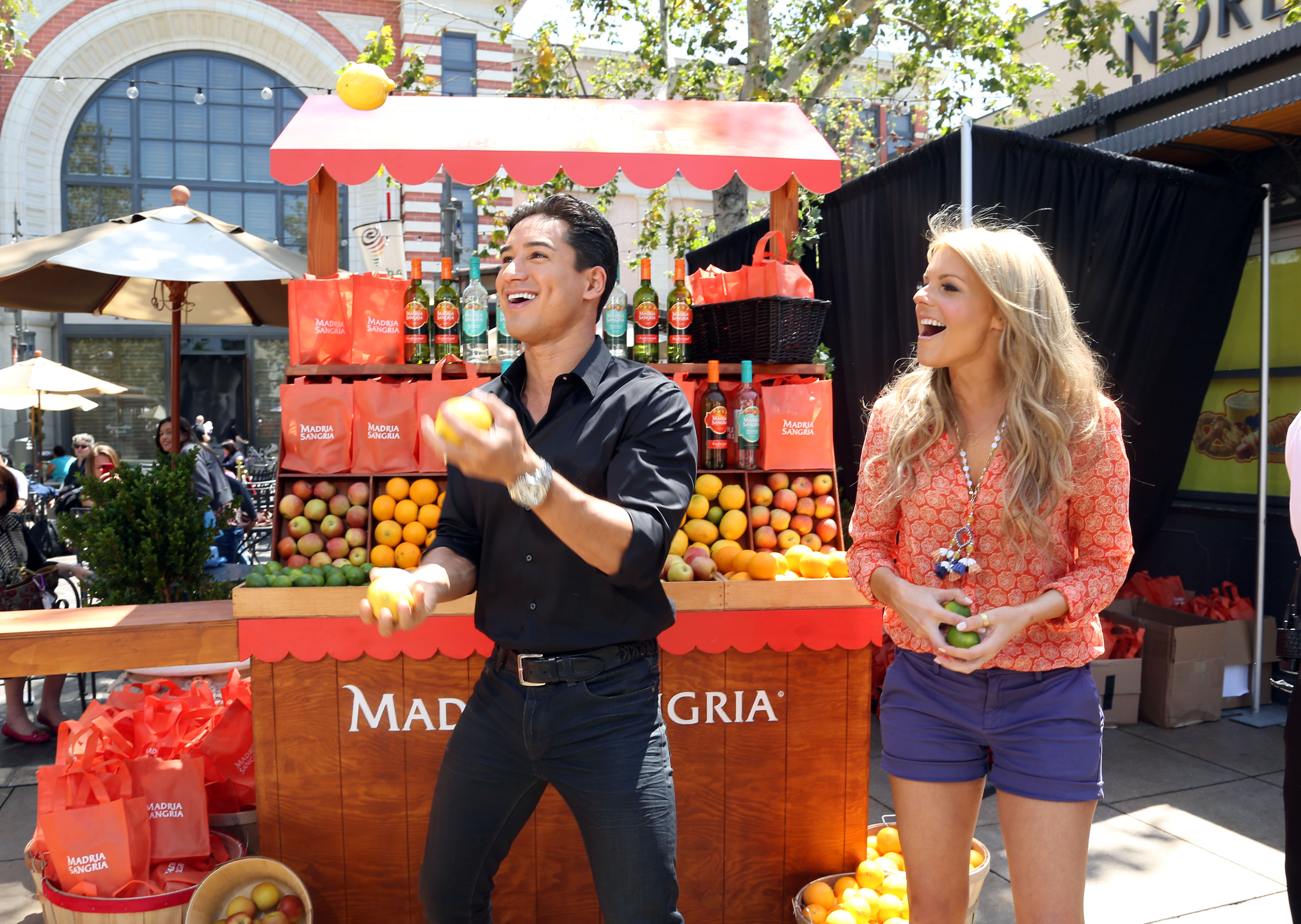 Ali Fedotowsky gears up for Cinco de Mayo at the Madria Sangria Fruit Stand with Mario Lopez on Extra's set April 26 at The Grove in L.A. (Sara Jaye Weiss)