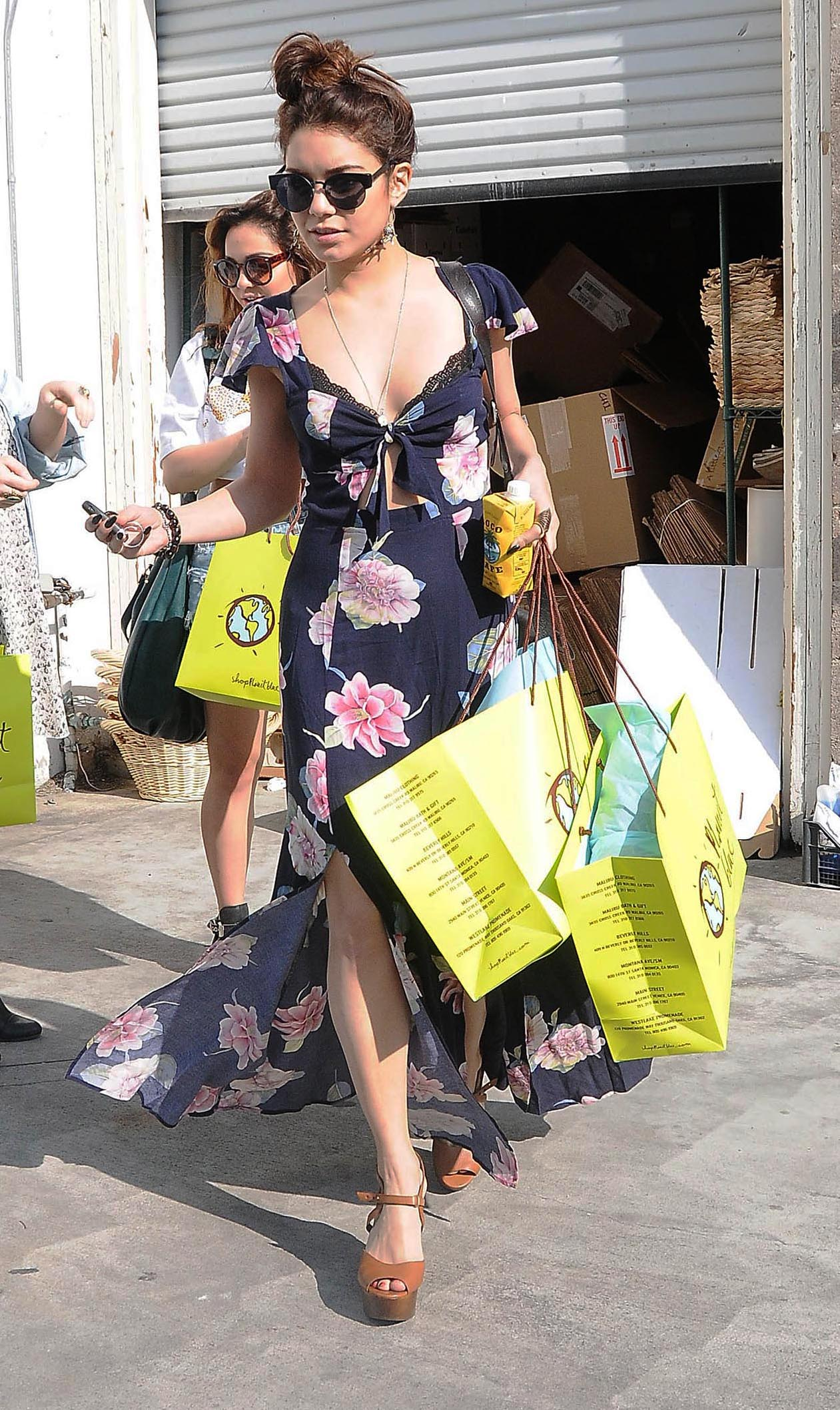 Vanessa Hudgens, juggles her shopping bags with her Coco Cafe beverage, while shopping in L.A. (Ramey Photo)
