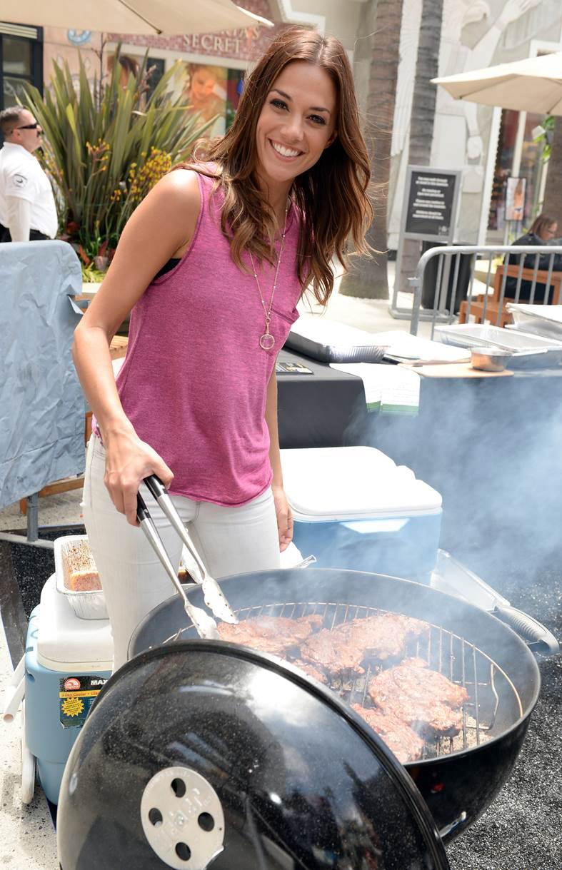 Country music star and One Tree Hill's Jana Kramer kicked-off Memorial Day weekend by filling up on Walmart's USDA Choice Premium Steaks, as she judged eight firefighter finalists from across the country on who had the best grilling skills before taking a shot at the grill herself at Walmart's Steak-Over Challenge national competition in LA. (WireImage)