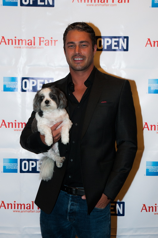 Taylor Kinney with Baby Hope at AnimalFair.com's 10-City Bark Business Tour Benefiting K9s For Warriors Kick-Off at the Omni Hotel in Chicago Sept. 7.