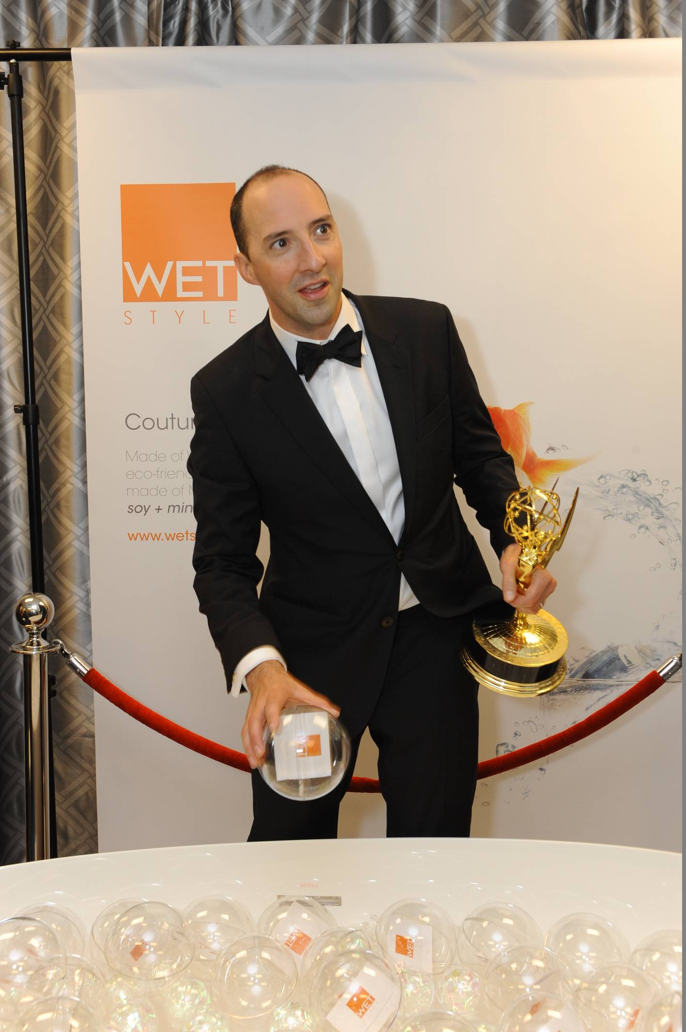 Tony Hale checks out Couture by WETSTYLE at the 65th Emmy Awards Giving Suite by Backstage Creations in L.A. Sept. 22. (Adrian Sidney/Invision)