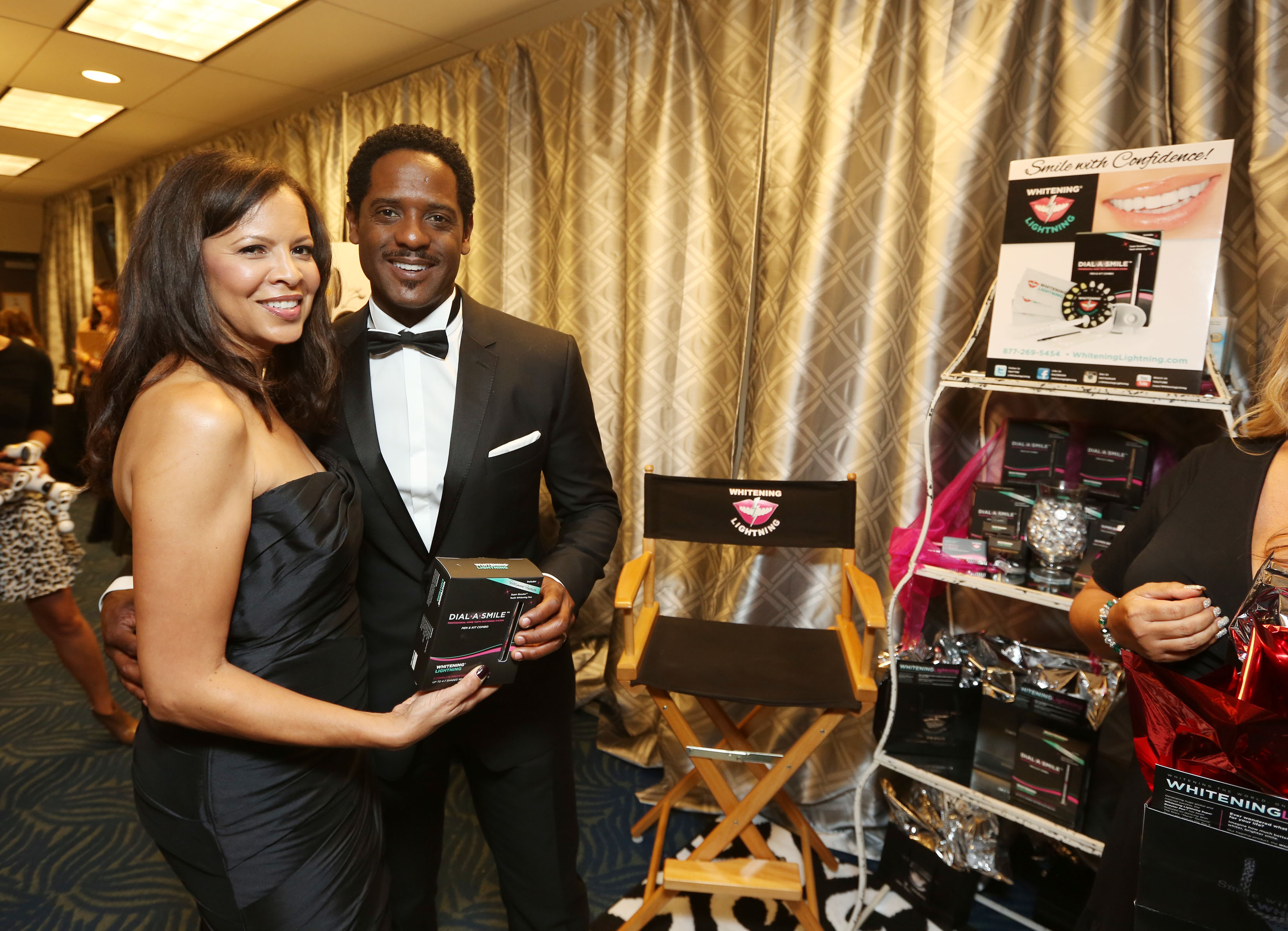 Blair Underwood and his wife Desiree DaCosta check out whitening lightning at the 65th Emmy Awards Giving Suite by Backstage Creations Sept. 21 in L.A.