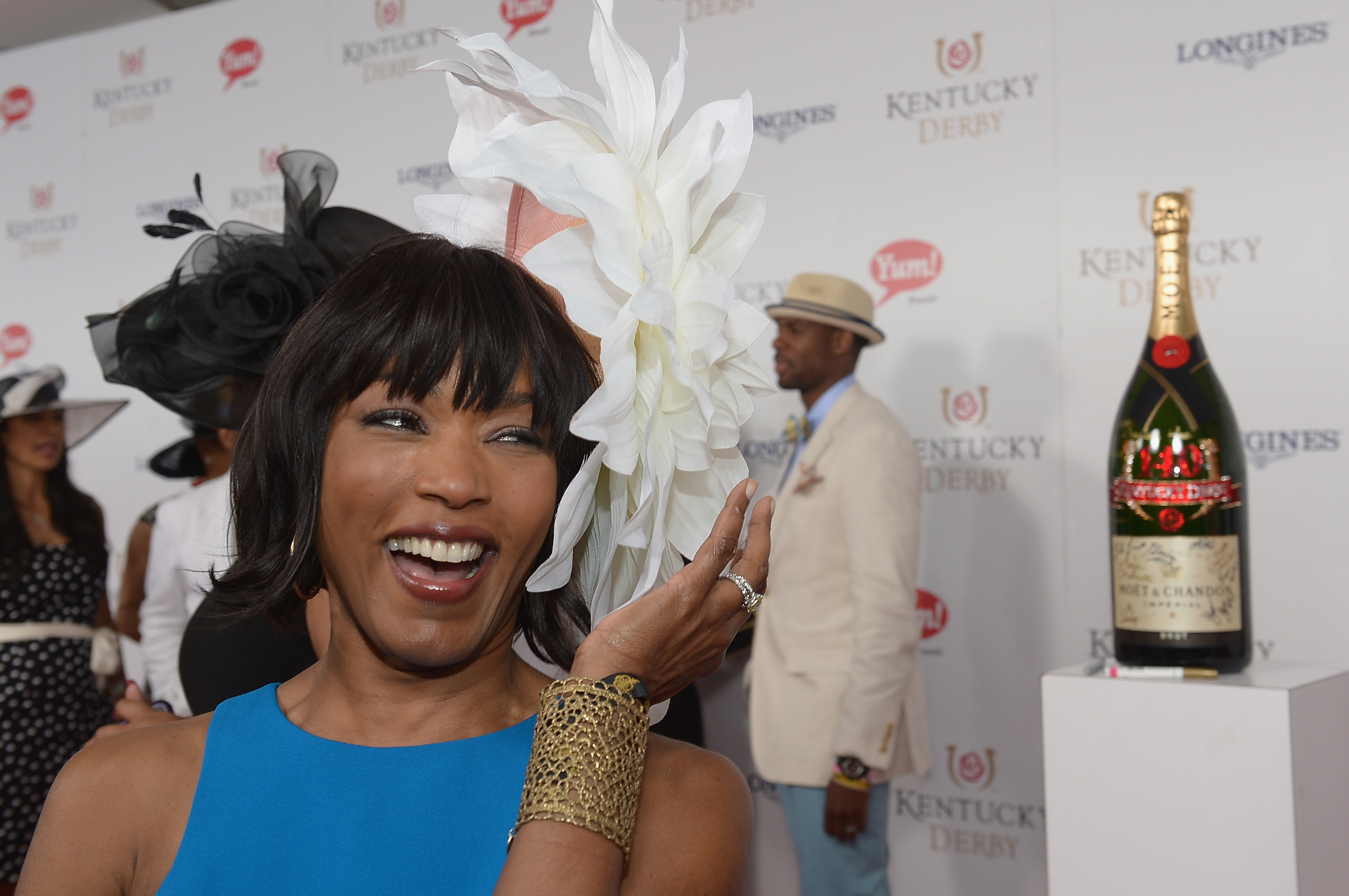 Angela Bassett toasts with Moet & Chandon at the 140th Kentucky Derby at Churchill Downs on May 3, 2014 in Louisville, Kentucky.  (Photo by Gustavo Caballero/Getty Images for Moet & Chandon)