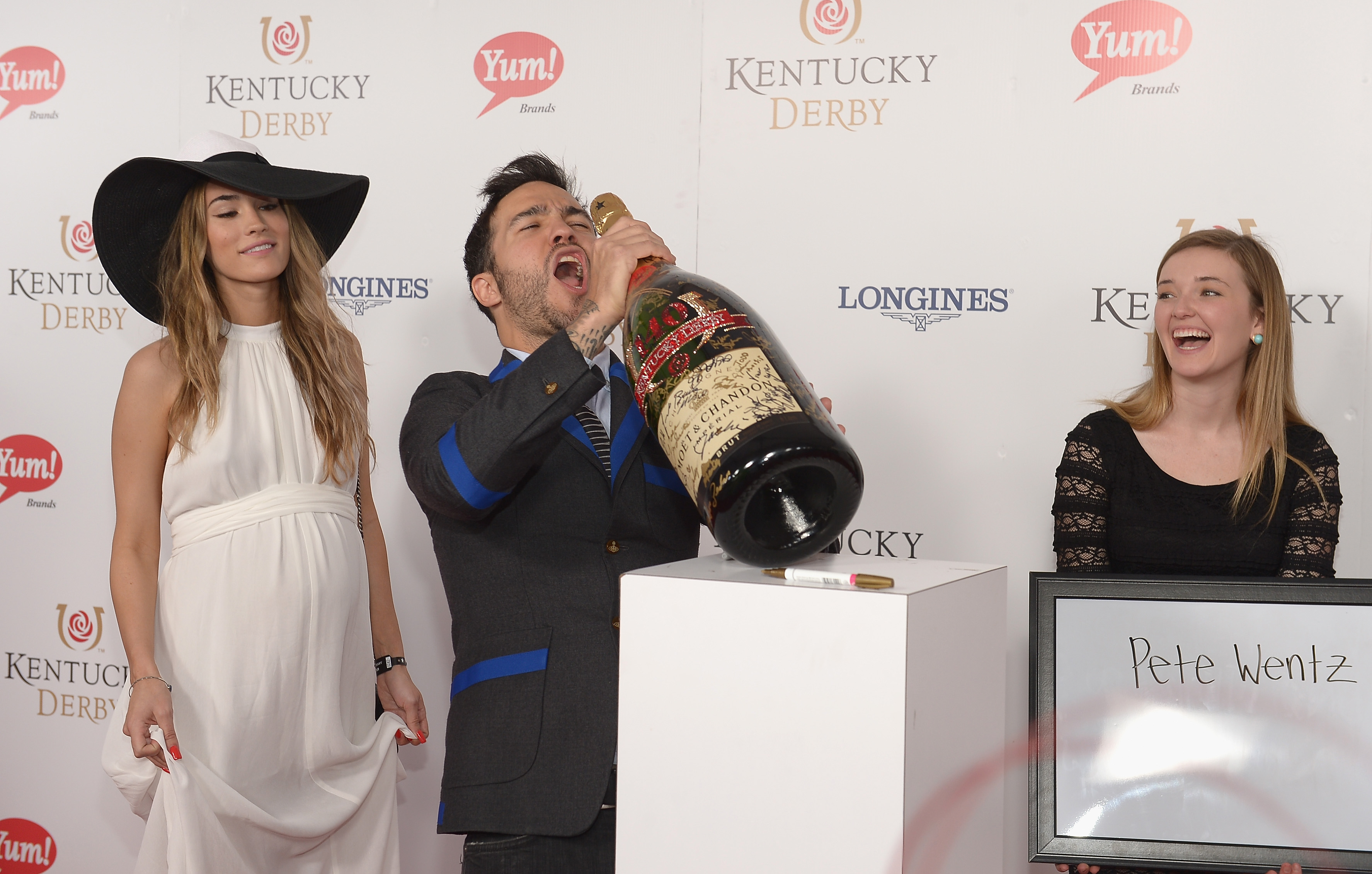 Pete Wentz toasts with Moet & Chandon at the 140th Kentucky Derby at Churchill Downs on May 3, 2014 in Louisville, Kentucky.  (Photo by Gustavo Caballero/Getty Images for Moet & Chandon)