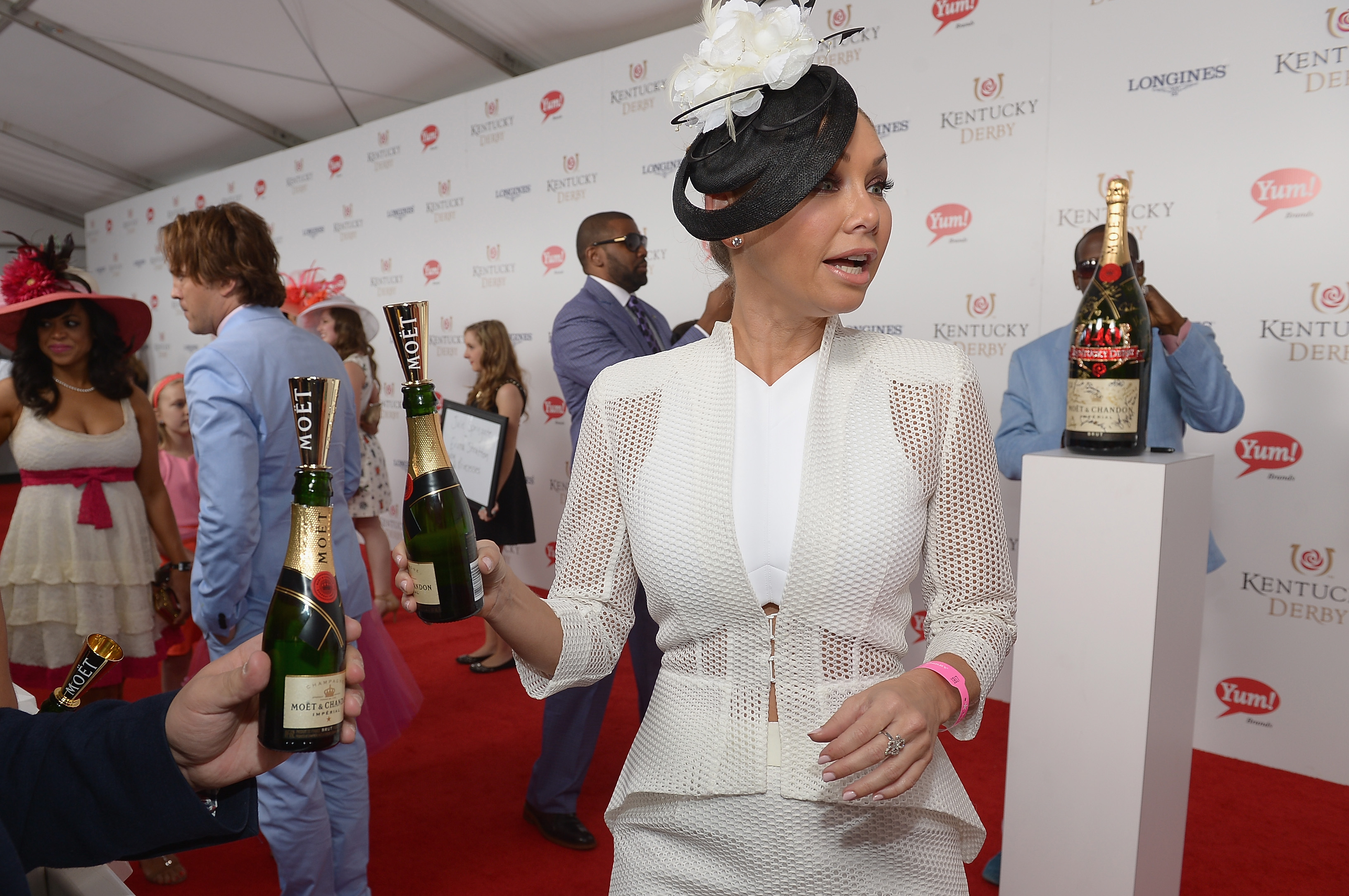 Dancing With The Stars' Kym Johnson toasts with Moet & Chandon at the 140th Kentucky Derby at Churchill Downs on May 3, 2014 in Louisville, Kentucky.  (Photo by Gustavo Caballero/Getty Images for Moet & Chandon)