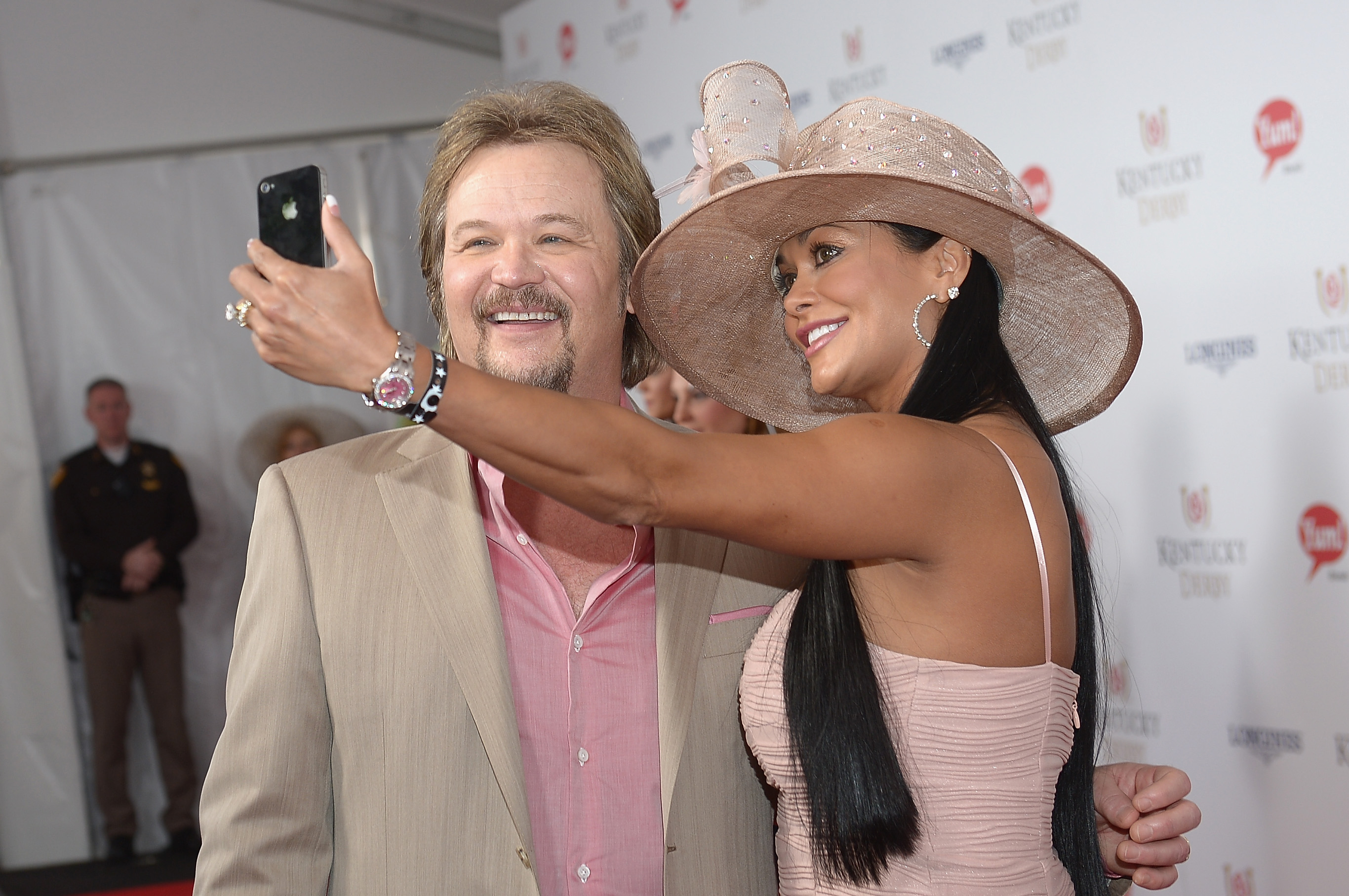 Travis Tritt and Theresa Nelson toast with Moet & Chandon at the 140th Kentucky Derby at Churchill Downs on May 3, 2014 in Louisville, Kentucky.  (Photo by Gustavo Caballero/Getty Images for Moet & Chandon)
