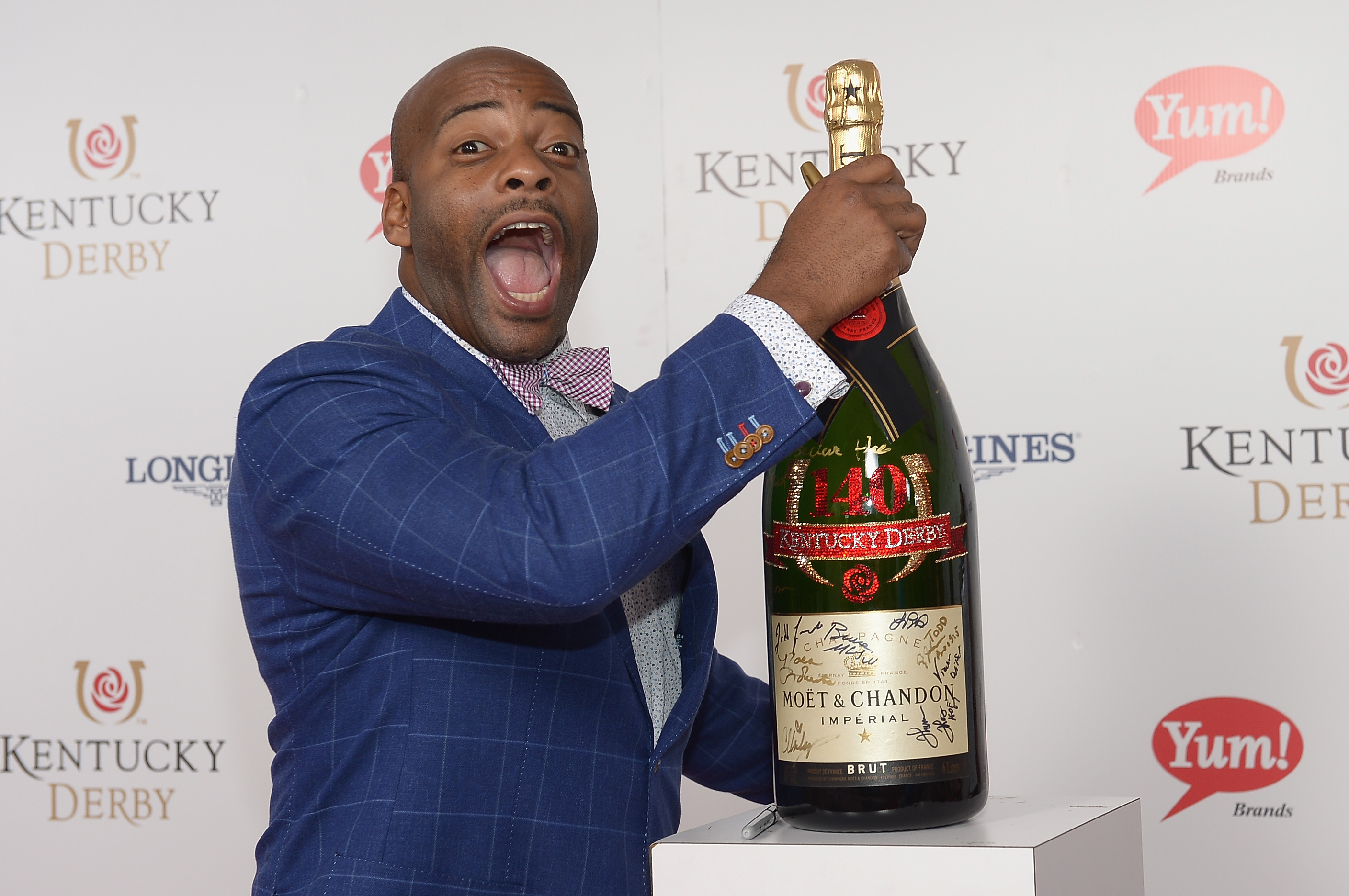 Former California State Assemblyman Isadore Hall toasts with Moet & Chandon at the 140th Kentucky Derby at Churchill Downs on May 3, 2014 in Louisville, Kentucky.  (Photo by Gustavo Caballero/Getty Images for Moet & Chandon)