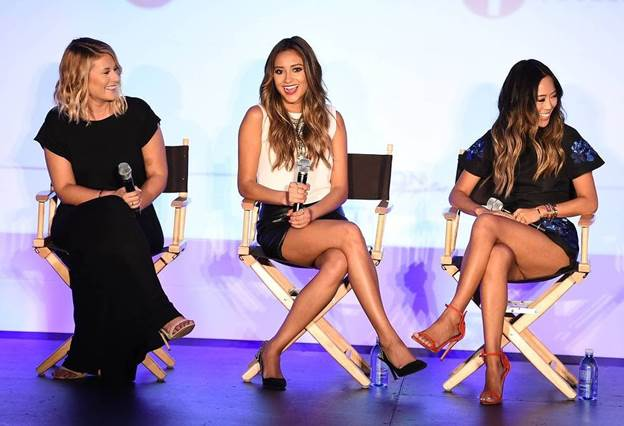 Michaela Blaney, Shay Mitchell and Aimee Song during their panel at BeautyCon LA presented by ELLE Magazine in L.A. Aug. 16. (Alex Wyman)