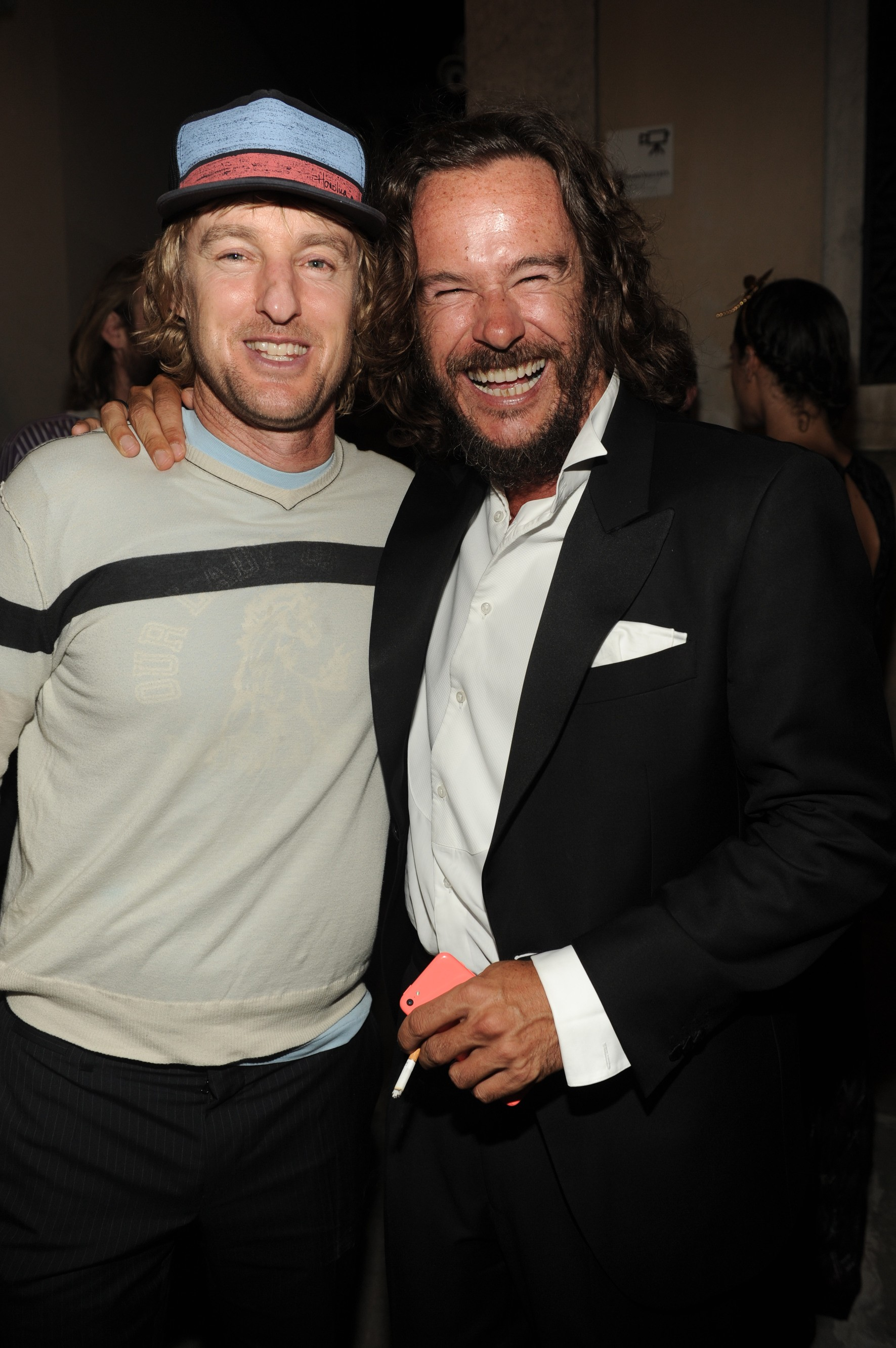 Owen Wilson and The PalazzinaG owner Emanuele Garosci attend The PalazzinaG Hotel's L'Uomo Vogue Dinner & Party sponsored by Chopard, Moët Chandon and Cotril