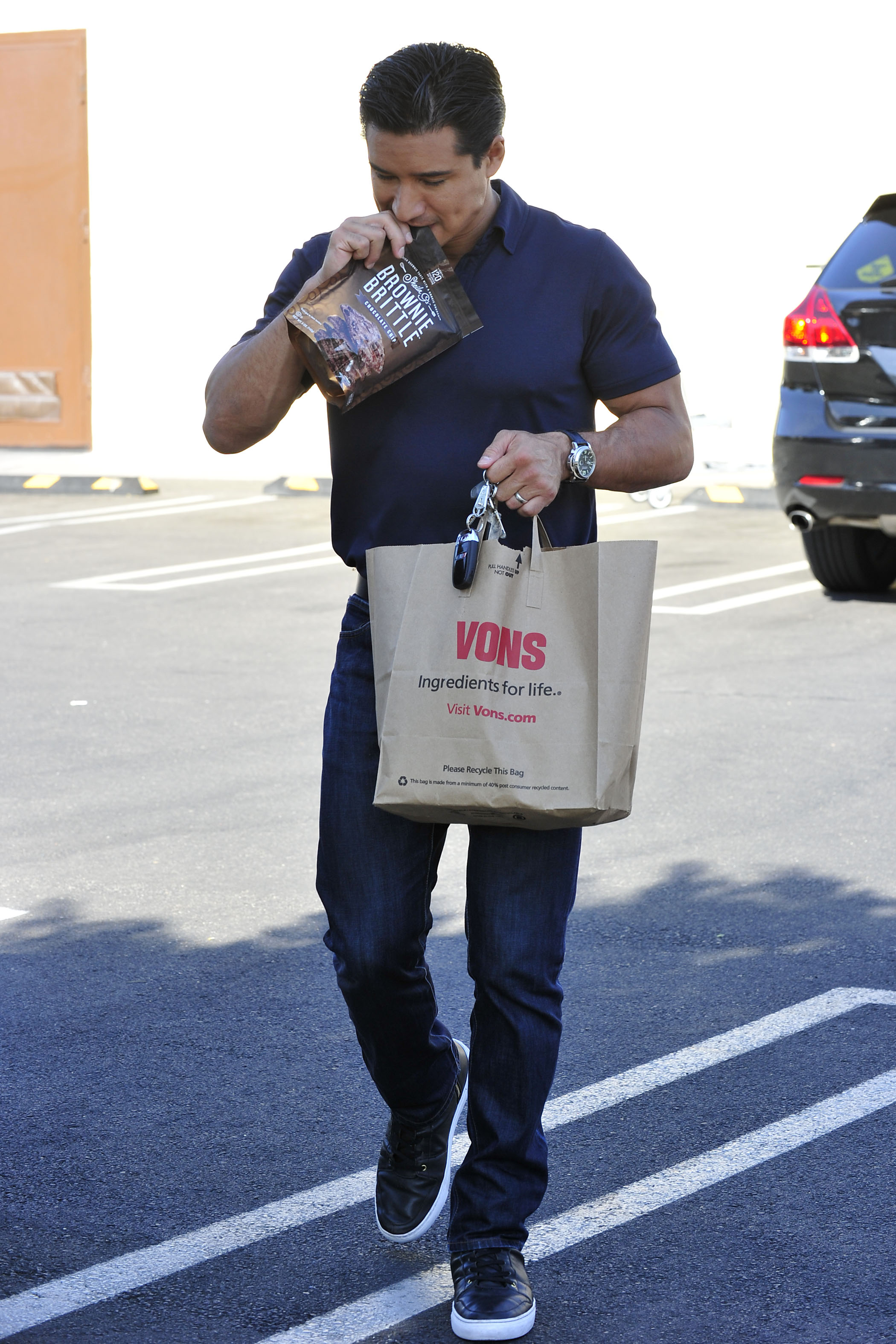 Mario Lopez leaves a an L.A. supermarket Oct. 20, but he clearly had a case of the munchies: He tore into Sheila G`s Brownie Brittle on the way back to his car. (Michael Simon/startraksphoto.com)