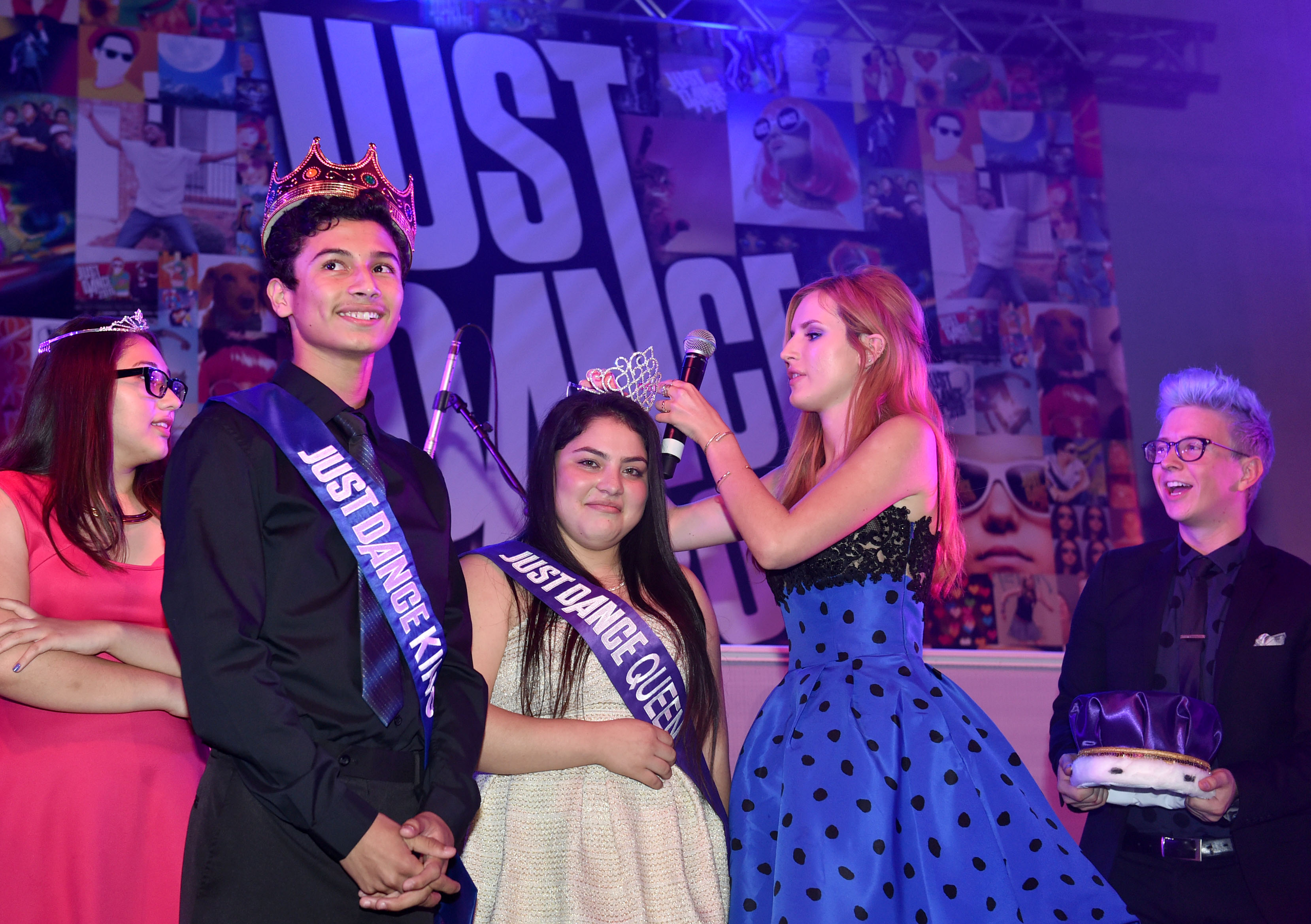 Bella Thorne crowns the homecoming king and queen on stage at the Just Dance Homecoming celebrating the launch of Just Dance 2015 at Aspire Pacific Academy on Wednesday, Oct. 22, 2014, in Huntington Park, Calif. (Photo by John Shearer/Invision for Ubisoft/AP Images)