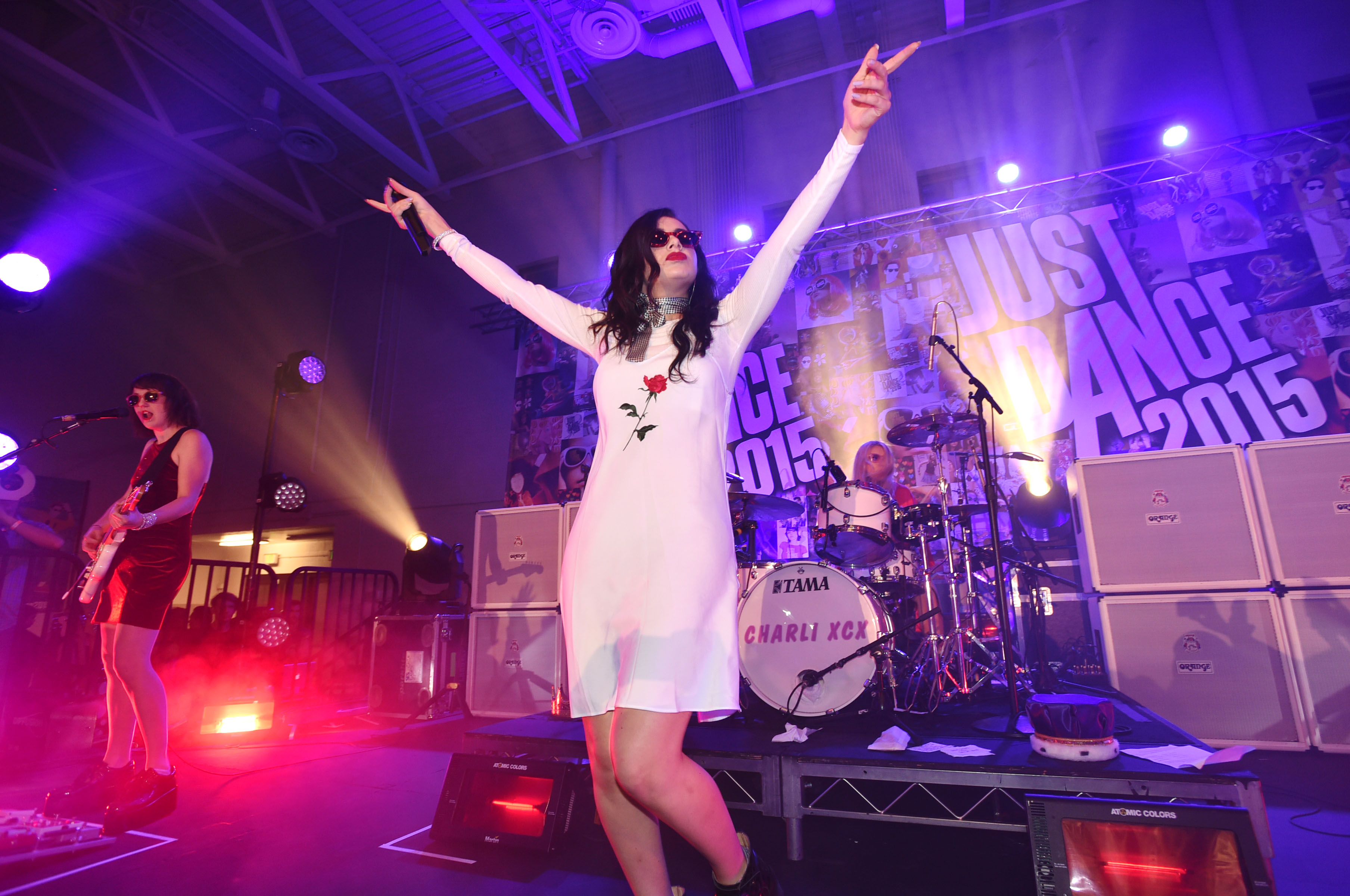 "Charli XCX performs ""Boom Clap,"" a track from Just Dance 2015, for students at the Just Dance Homecoming at Aspire Pacific Academy on Wednesday, Oct. 22, 2014, in Huntington Park, Calif. (Photo by John Shearer/Invision for Ubisoft/AP Images)"