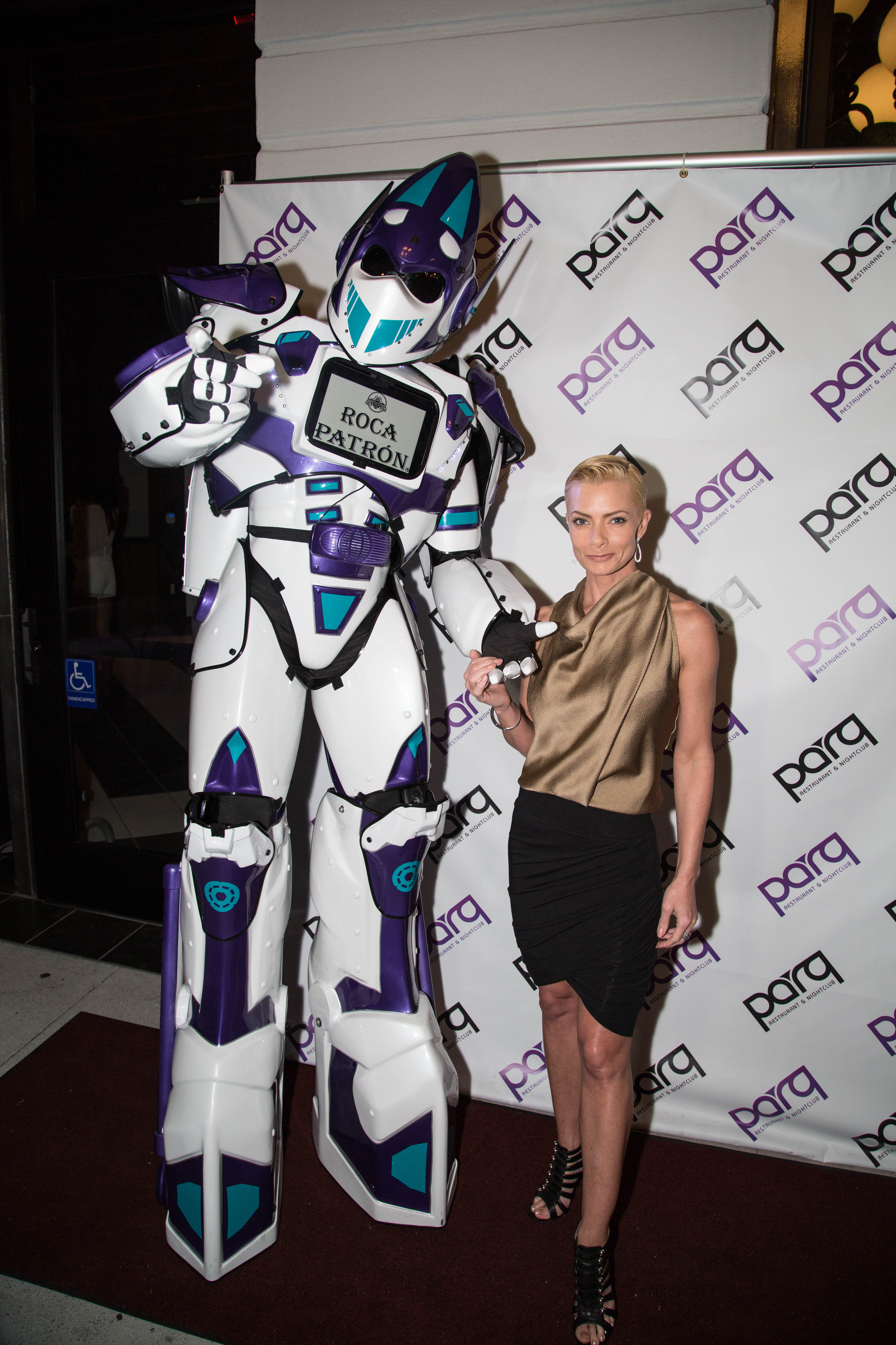 Jaime Pressly gets acquainted with Parq Restaurant & Nightclub's 10-foot-tall foot robot — aka Parq Rocatron — at its grand opening on Oct. 25. (Julien Jollon)