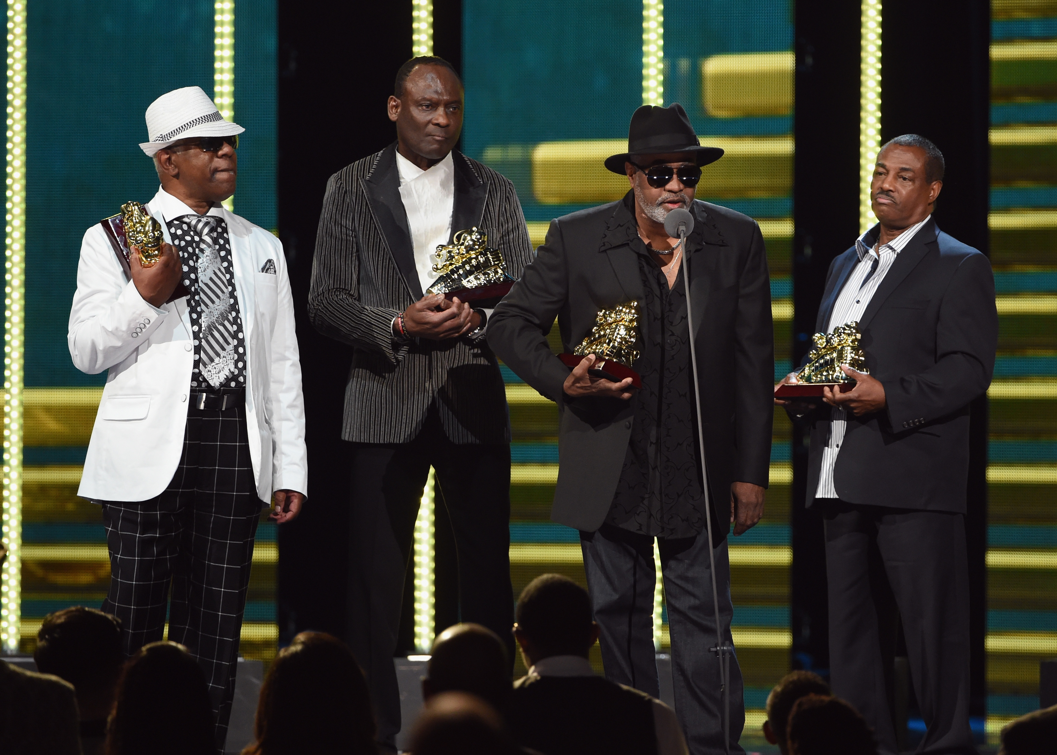 "LAS VEGAS, NV - NOVEMBER 07:  (L-R) Honorees Dennis Thomas, George Brown, Robert ""Kool"" Bell and Ronald Bell of Kool and the Gang speak onstage during the 2014 Soul Train Music Awards at the Orleans Arena on November 7, 2014 in Las Vegas, Nevada.  (Photo by Ethan Miller/BET/Getty Images for BET)"