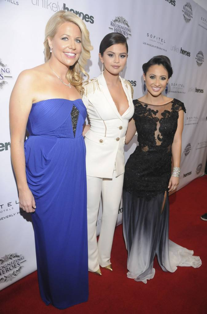 Selena Gomez flanked by Unlikely Heroes founder/CEO Erica Greve (left) and host Francia Raisa at the 3rd Annual Unlikely Heroes Awards Dinner and Gala to Benefit Child Victims of Sex Slavery Sponsored by XXIV Karat Sparkling Wines at the Sofitel L.A. in Beverly Hills Nov. 8. (Vivien Best/Getty Images)