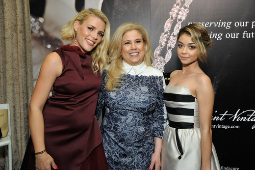 Busy Phillips and Sarah Hyland flank Saint Vintage Founder and Designer Paige Jensen-Nichols at the the 2nd Annual unite4:humanity presented by ALCATEL ONETOUCH at the Beverly Hilton Hotel on February 19, 2015 in Los Angeles, California.