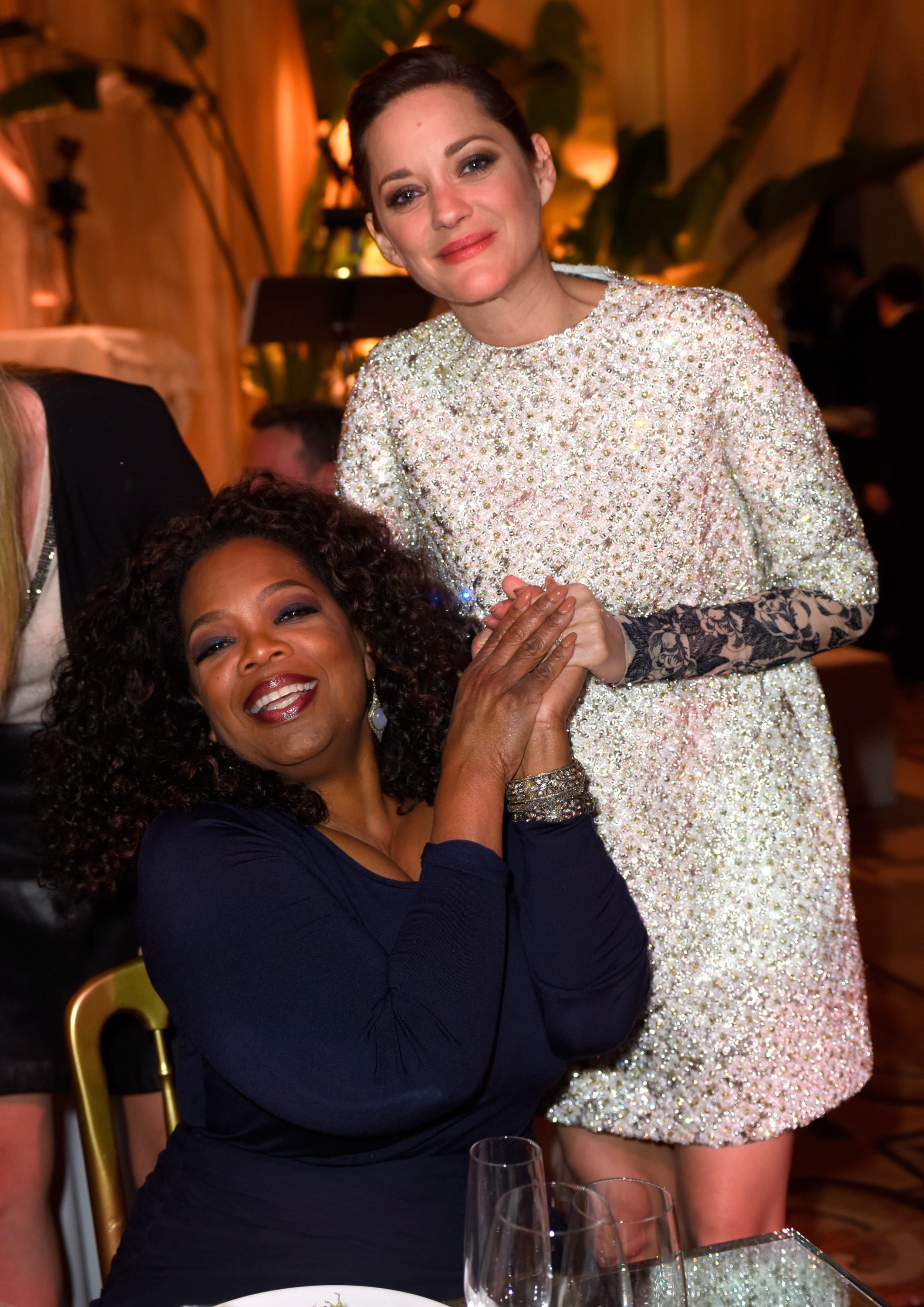 Oprah Winfrey and Marion Cotillard at The Weinstein Company's Academy Awards Nominees Dinner, hosted by Meiomi Wines on February 21, 2015 at The Montage in L.A.  (Charley Gallay/Getty Images)