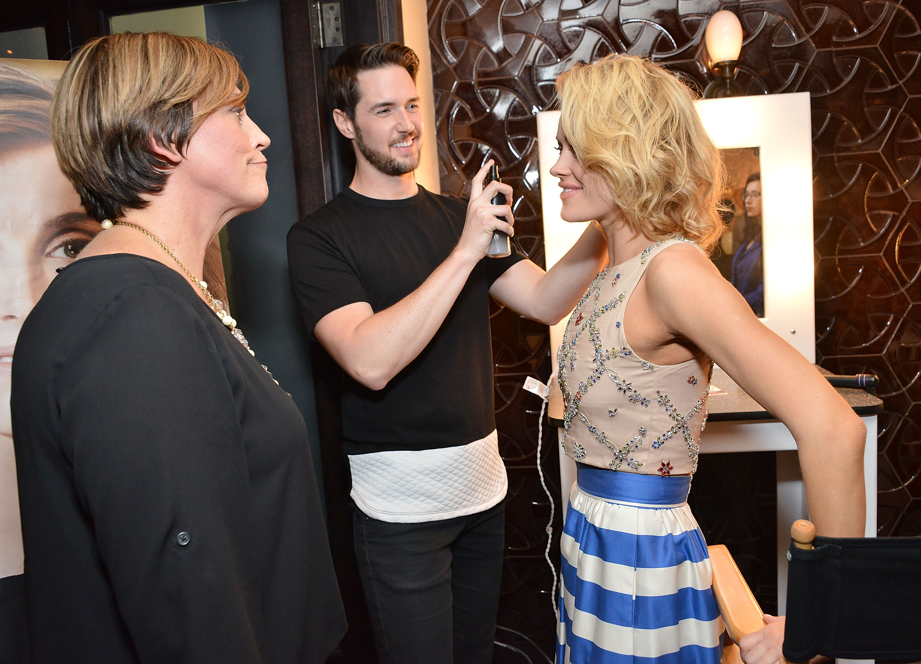 Peta Murgatroyd (far right) gets glammed up by celeb hair stylist Paul Norton (while Joico VP Sara Jones looks on) at Joico's Hair Shake Launch, hosted by Murgatroyd,  at The District Restaurant in L.A April 30. (Araya Diaz/Getty Images)
