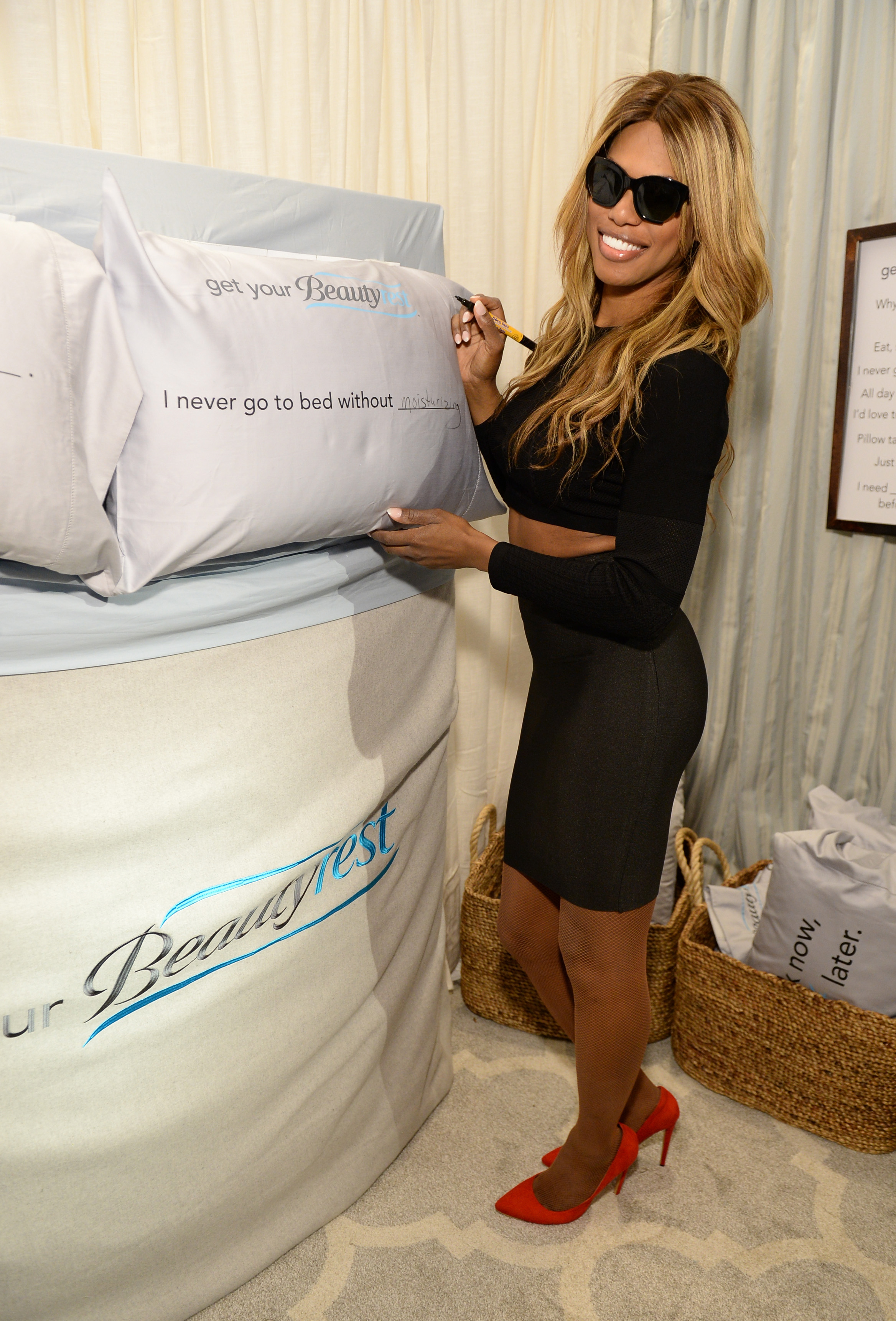 "Laverne Cox is ready for a pillow fight with Beautyrest Mattresses at EXTRA's ""WEEKEND OF 